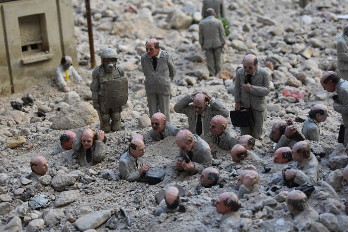 "Detail of ""Following the leader"", by Isaac Cordal"