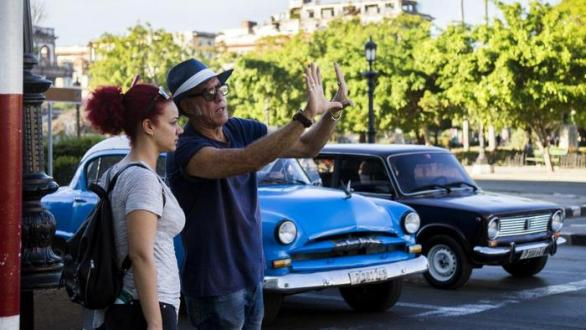 Filming in the streets of Havana. Arturo Santana, director and Iris Abreu, assistant director